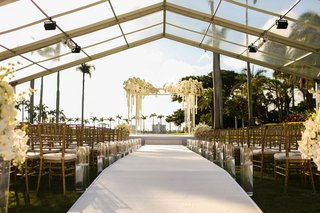 wedding-ceremony-the-mar-a-lago-club-view-of-palm-trees-white-flowers-gold-chairs