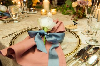 wedding-reception-pattern-linen-with-single-rose-flower-at-each-guest-place-setting