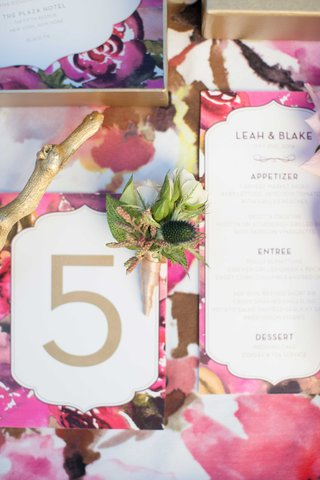 floral-print-inspired-by-coco-chanel-table-linen-white-and-gold-calligraphy-on-wedding-menu