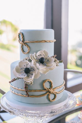 light-blue-wedding-cake-with-gold-rope-details-and-white-sugar-anemones
