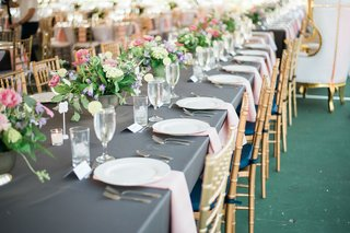 grey-linens-gold-chiavari-chairs-blush-napkins-row-of-small-centerpieces-head-table