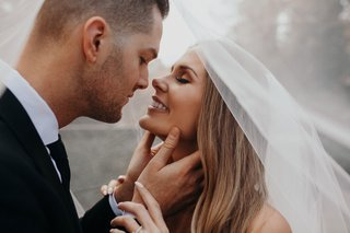 suzanna-villarreal-and-alex-wood-la-dodgers-wedding-portrait-almost-kiss-under-veil