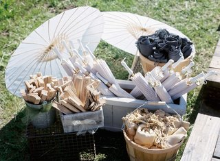 wood-fans-and-white-parasols-in-crates-and-boxes