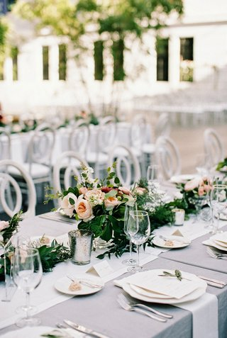 A Charming Fete Reception with Low Centerpiece colorful flowers romantic