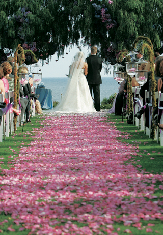 bride-and-groom-at-altar-at-end-of-flower-petal-aisle