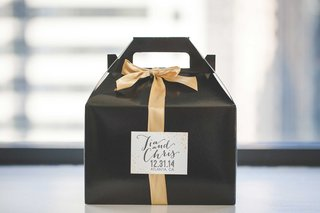 black-favor-box-with-gold-ribbon-and-white-label-for-new-years-eve-wedding-guests