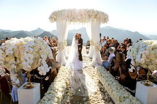 wedding ceremony structure santa monica mountain pacific ocean view kiss husband and wife