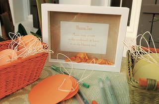 materials-on-table-for-wedding-blessing-tree-with-framed-sign