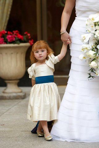 redhead-wearing-ivory-dress-and-gold-shoes