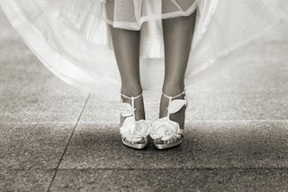 black-and-white-photo-of-bride-wearing-heels