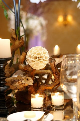 white-rustic-pod-flower-with-woodsy-centerpiece
