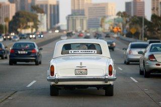 just-married-antique-getaway-car-on-freeway