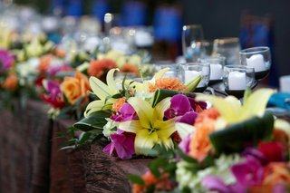 flowers-in-tropical-colors-on-edge-of-table