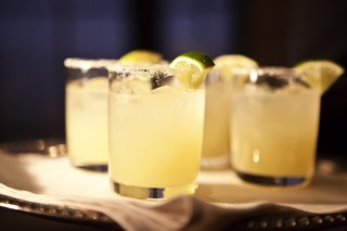 short-glass-cups-of-margarita-with-salt-and-lime