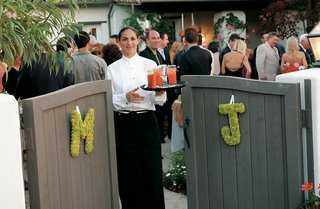 signature-cocktails-awaited-guests-behind-gate-with-flower-initials
