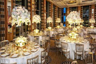 opulent-tablescapes-white-linens-gold-charger-plates-clear-glass-vases-tall-white-floral-arrangement