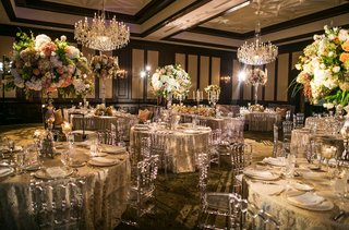 the-reception-venue-and-decor-with-flowers-chandeliers-glassware-and-candles