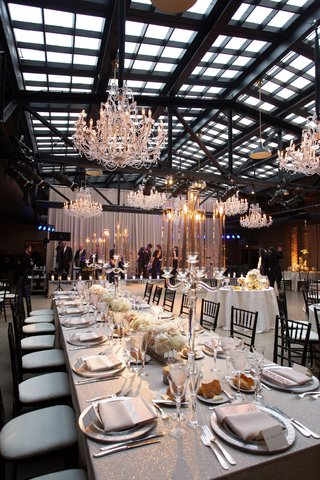 wedding-reception-revel-motor-row-chandelier-silver-glitter-linens-low-centerpiece-crystal-candles