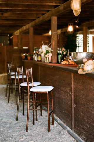 barstools-at-rustic-country-bar-for-barn-wedding