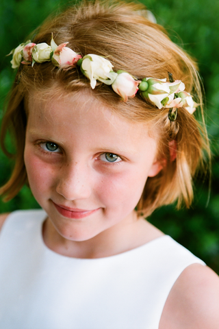 flower-girl-with-red-hair-wearing-pink-and-white-flower-crown
