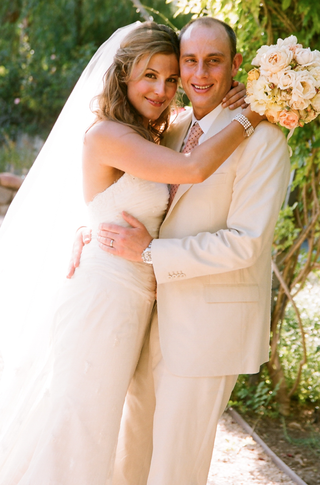 tan-grooms-suit-and-white-wedding-dress