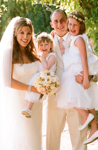 bride-and-groom-hold-young-flower-girls