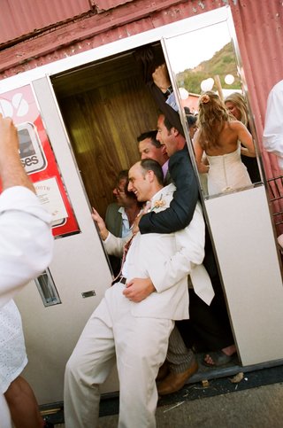 groom-with-friends-in-outdoor-wedding-photobooth