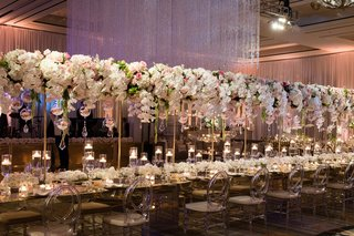 wedding-reception-crystal-ceiling-installation-with-long-head-table-flowers-floating-overhead-candle