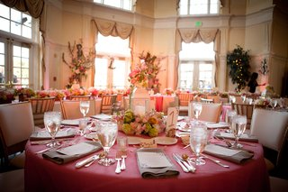 wedding-reception-table-with-pink-tablecloth-lantern-centerpiece-with-green-hydrangeas-and-pink-rose