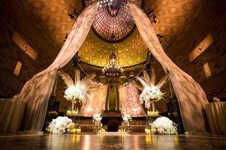 wedding-ceremony-art-deco-vintage-theme-gotham-hall-new-york-city-white-flowers-palm-trees-leaves