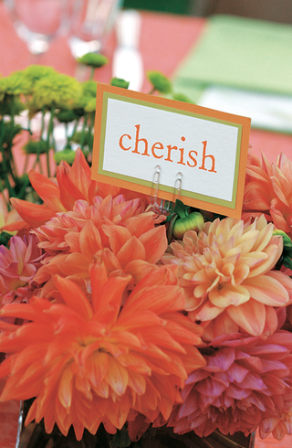 cherish-table-name-idea-on-bed-of-orange-dahlias
