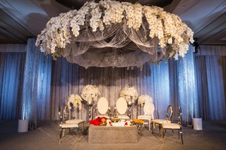 elegant-altar-floral-fixture-overhead-coffee-table-colorful-blossoms-indian-hindu-wedding-california
