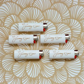 white-lighters-with-gold-couples-names-as-wedding-favor