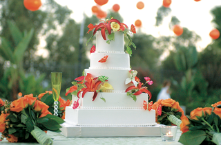 five-layer-white-wedding-cake-with-edible-tropical-flowers