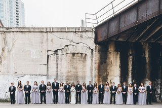wedding-party-large-suits-and-tuxedos-light-purple-bridesmaid-dresses-with-matching-bouquets