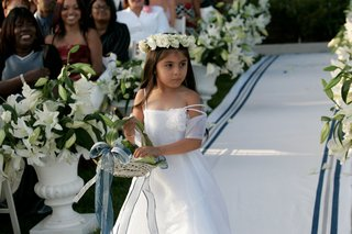pretty-flower-girl-walking-down-white-and-blue-aisle