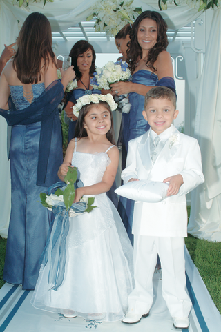little-boy-and-girl-wearing-white-on-aisle-runner