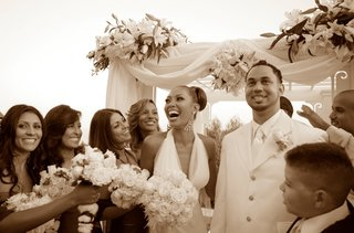sepia-toned-photo-of-bridesmaids-and-couple