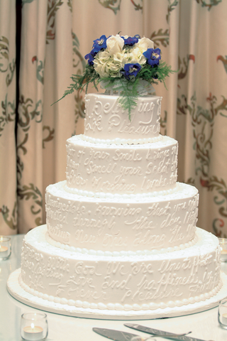 four-layer-cake-with-inscription-and-flowers