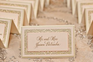 wedding-escort-card-in-pale-pink-green-gold-calligraphy-laser-cut-border