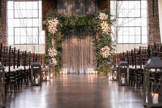 chuppah-made-with-greenery-and-clumps-of-ivory-flowers-interfaith-ceremony