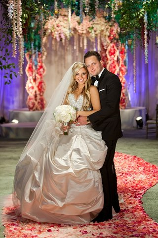bride-in-princess-dress-and-groom-in-indoor-garden