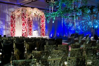 wedding-ceremony-with-green-chairs-and-pink-flower-chuppah