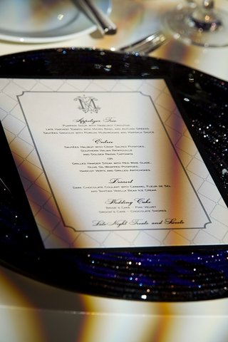 lattice-patterned-wedding-menu-card-on-glitter-plate