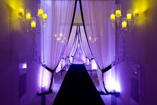 black-and-white-man-made-tunnel-with-lucite-candelabras