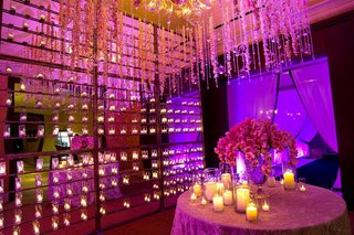 mirror-reception-room-with-candle-wall-and-orchids