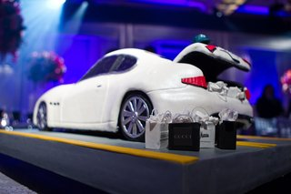 white-maserati-cake-with-edible-shopping-bags