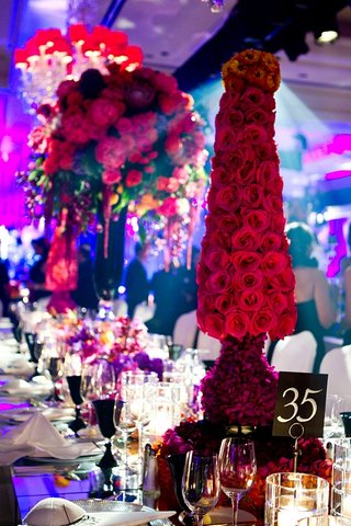 hot-pink-roses-in-shape-of-cone-on-reception-table