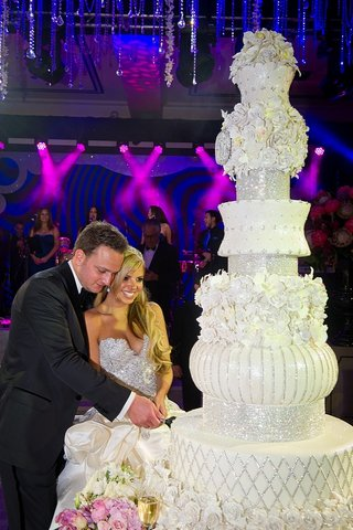 bride-and-groom-cut-seven-foot-tall-wedding-cake