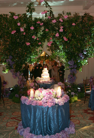 blue-sweetheart-table-covered-with-purple-flowers